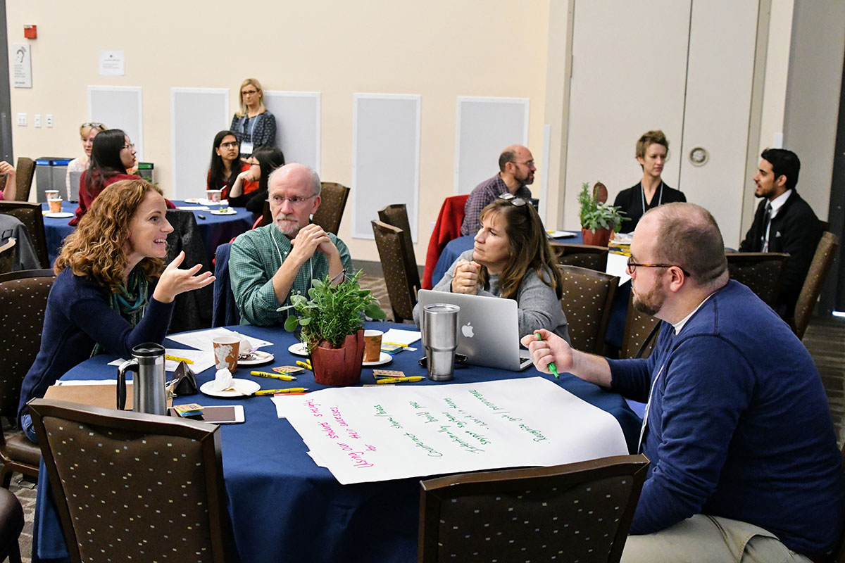 A lively table discussion during the plenary talk.